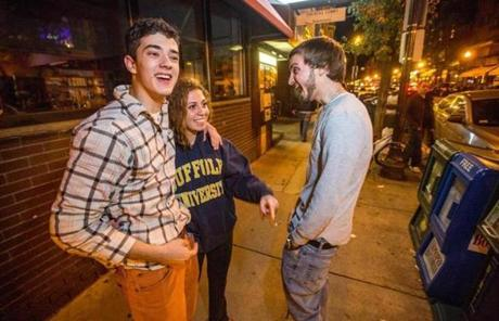 Alex Blaze, 18, Julianne Jeha, 18, and AJ Furtado, 19, yelled while standing on Hanover Street  after 1 a.m. Jeha wore a Suffolk University sweatshirt. Suffolk receives a lot of the blame for the noise from North End residents.